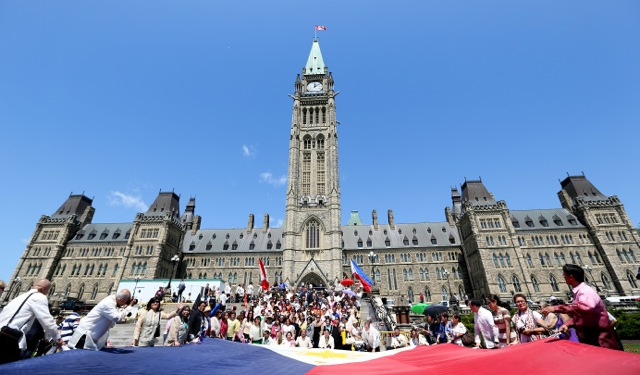 Historic first Philippine flag raising ceremony on Parliament Hill, June 12, 2013