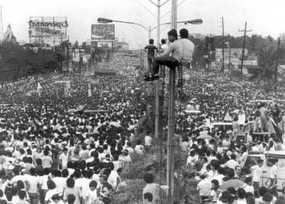 Millions gathered three decades ago at the site just outside the main military and police camps in a largely peaceful uprising to oust Marcos, ending a presidency marked by massive corruption and human rights violations. (Wikimedia Commons)