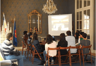 Filipino students watch the Embassy's presentation on Philippine foreign policy.