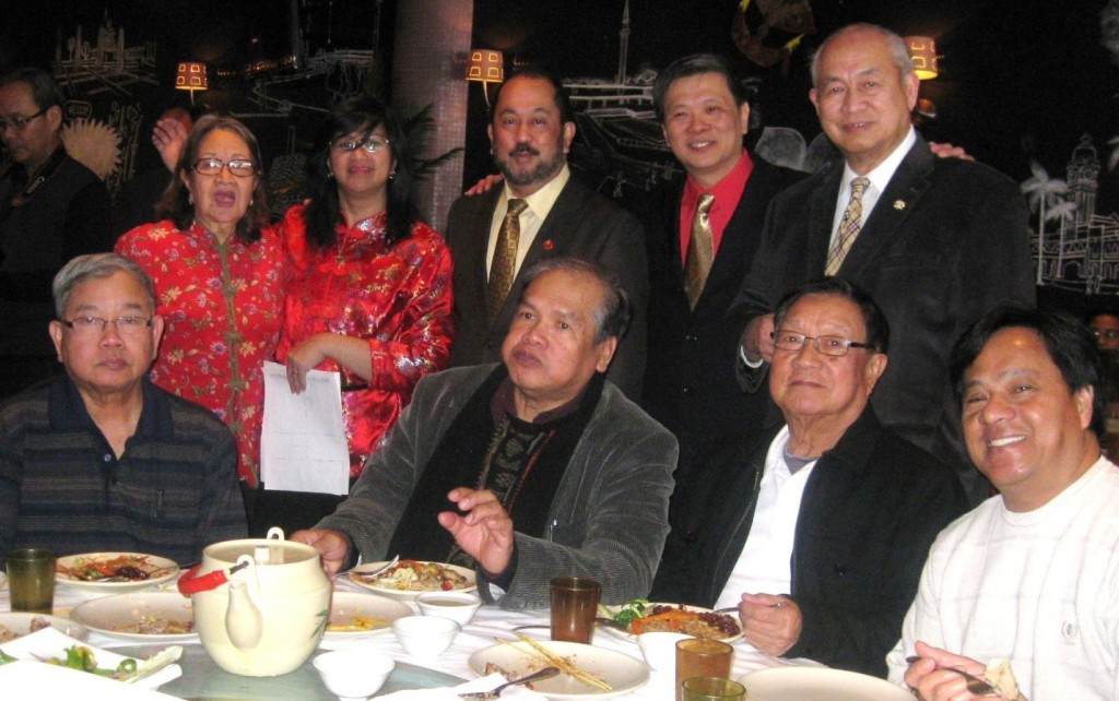TCDSB Trustee Garry Tanuan (standing, 2nd from right) with Hon. Senator Tobias C. Enverga Jr., Sir George R. Poblete; with Marla Tanuan and her mother; Others sitting are:  Ray Start, Ed Valente, Meynard Sitchon, Ramon Cezar, Elena Dicion and Mary Anne Guya.