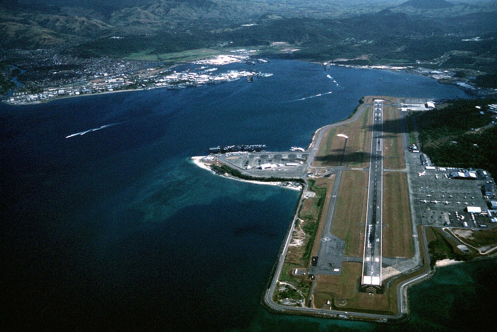 An aerial view of the station and, in the background, Naval Air Station, Cubi Point, Subic Bay, Philippines. Photo courtesy of PH1 David R. Sanner on Wikipedia.