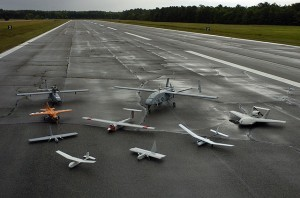 Group photo of aerial demonstrators at the 2005 Naval Unmanned Aerial Vehicle Air Demo, also known as drones. (Wikipedia photo)