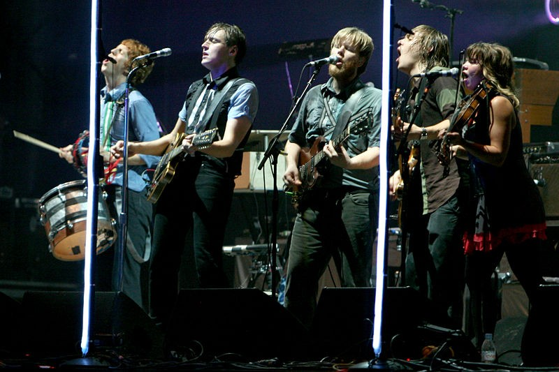 Arcade Fire performing at Rock en Seine in 2007. Photo by Bertrand / Wikimedia Commons.