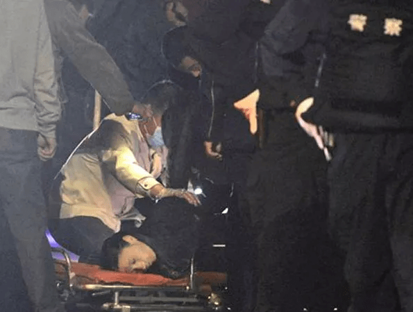 The body of a victim is inspected by police officers outside a railway station, after an attack by knife wielding men left 27 dead in Kunming, in southwestern China's Yunnan province, Saturday March 1, 2014. China's official Xinhua News Agency says authorities consider the attack by a group of knife-wielding assailants at a train station in southwestern China in which at least 27 people died and over 100 were injured, to be an act of terrorism. AP