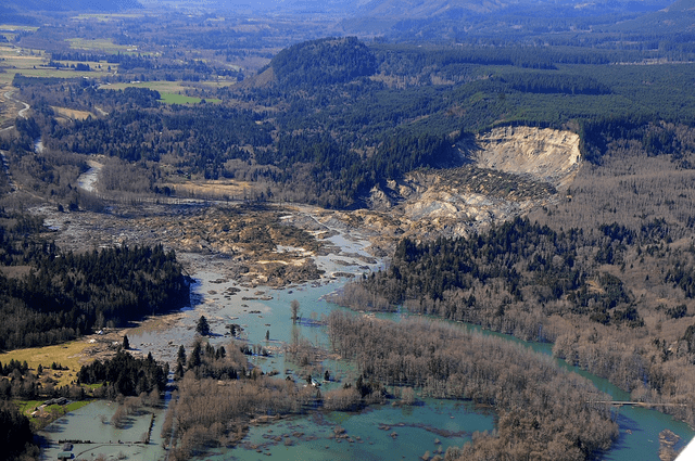 Aerial photograph of the Oso mudslide, taken by the Washington State Patrol on 2014-3-23. (Wikipedia photo)