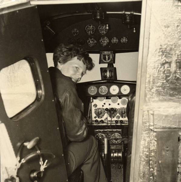 Earhart in the Electra cockpit, c. 1936. (Wikipedia photo)