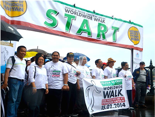 "Consul General Anne Jalando-on Louis (2nd from left) and Consul Marford Angeles joins Iglesia ni Cristo (INC) ministers led by District Minister Renniel Serreno (6th from left) and a thousand INC members and friends at the ""Worldwide Walk for those affected by Typhoon Haiyan' held in Sydney on 15 February 2014. (Photo courtesy of Mr. Romy Cayabyab)"