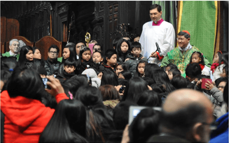 Cardinal Tagle is flocked by children of Filipinos after the Holy Mass.