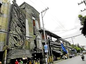 "Franceso Monti's ""The Furies"" installed on the old Meralco Building. FILE PHOTO INQUIRER.NET"