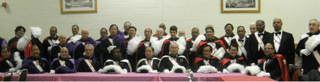 Above photo shows the Faithful Navigator SK Wifred Gomez (5th from left sitting) with the  past Faithful Navigators SK Rudy Montanitel, SK Bob Atkinson, SK George R. Poblete, SK Dan McNeil,  SK Walter D'Souza, SK Eric Serapio (white cape,) the Commanders (Purple capes) and the Sir Knights (red capes.)