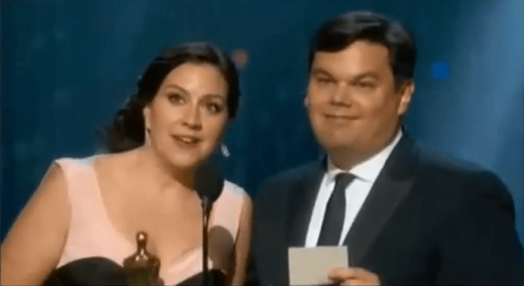 The Lopezes accepting their first Academy Award. Screengrab from YouTube.