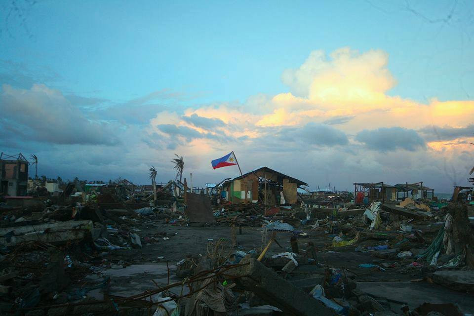 The Philippine flag stayed atop, amidst Yolanda's destruction. Photo: Facebook Page of Typhoon Yolanda Vital Relief and Livelihood Missions