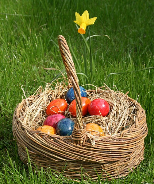Colored Easter eggs in a straw basket. (Wikipedia photo)