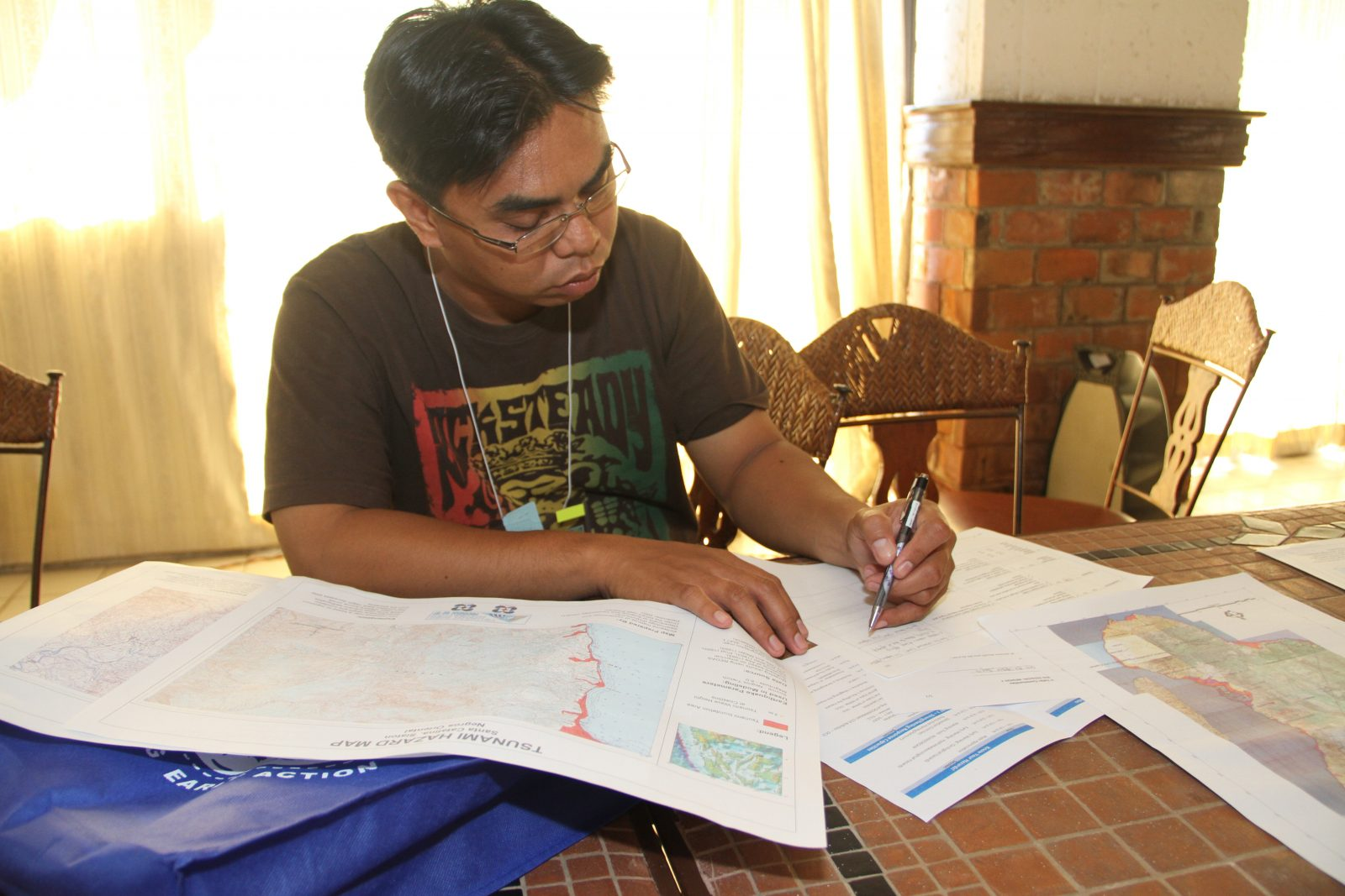 A member of the Negros Oriental delegation uses a tsunami hazard map during a workshop.
