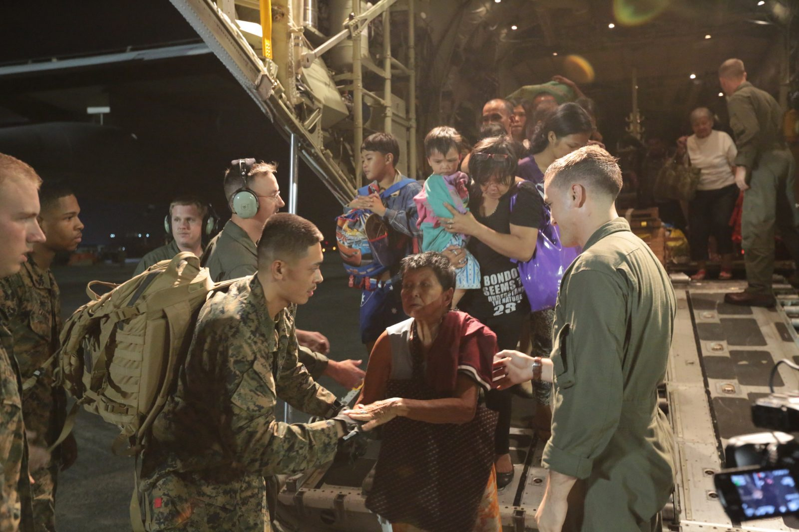 U.S. Marines help displaced Philippine nationals from the back of a KC-130J Super Hercules at Vilamor Air Base, Manila, Republic of the Philippines Nov. 11. Super Typhoon Haiyan has impacted more than 4.2 million people across 36 provinces in the Philippines, according to the Philippine government's national disaster risk reduction and management council. Photo by Lance Cpl. Caleb Hoover / Wikipedia