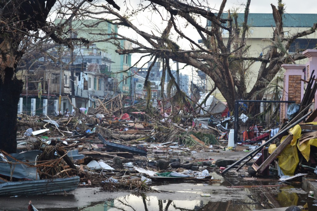 Debris lines the streets of Tacloban, Leyte island. This region was the worst affected by the typhoon, causing widespread damage and loss of life. Caritas is responding by distributing food, shelter, hygiene kits and cooking utensils. (Photo: Eoghan Rice - Trócaire / Caritas; Wikipedia)