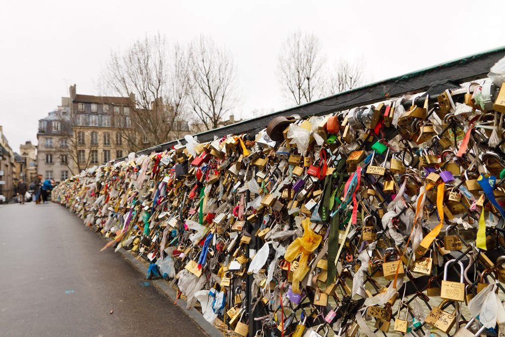 Love padlocks at Pont de l'Archeveche in Paris. The thousands of locks of loving couples symbolize love forever. Patrick Poendl / Shutterstock