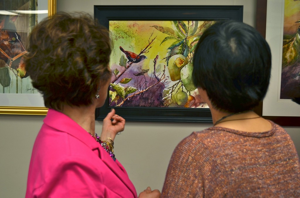 PAG President Nelia Tonido shows her friends one of her paintings