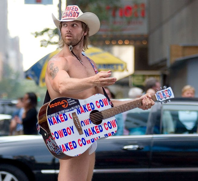 The Naked Cowboy in Times Square. Photo by Ryan McGinnis / Wikimedia Commons.