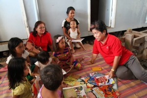 DSWD Sec. Dinky Soliman with children. File photo courtesy of DSWD on Facebook.