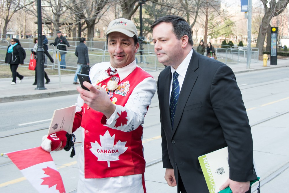 Jason Kenney (right) selfie with Mr. Canada. Scenes of the State Funeral for Jim Flaherty, former Minister of Finace of Canada, held at St. James Cathedral in Toronto. rmnoa357 / Shutterstock