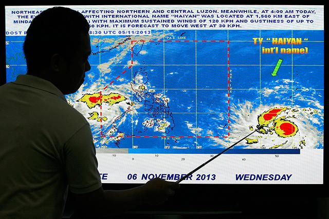 A weather forecaster shows the location of super typhoon 'Haiyan' at the PAGASA office in Quezon City. Asti Flores / GMA News