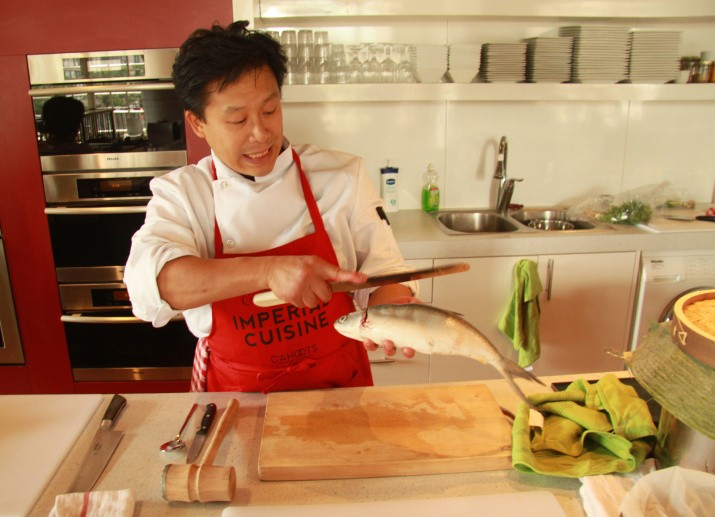 Jovanni Sy preparing rellenong bangus in 'A Taste of Empire.' Photo by Keith Barker.