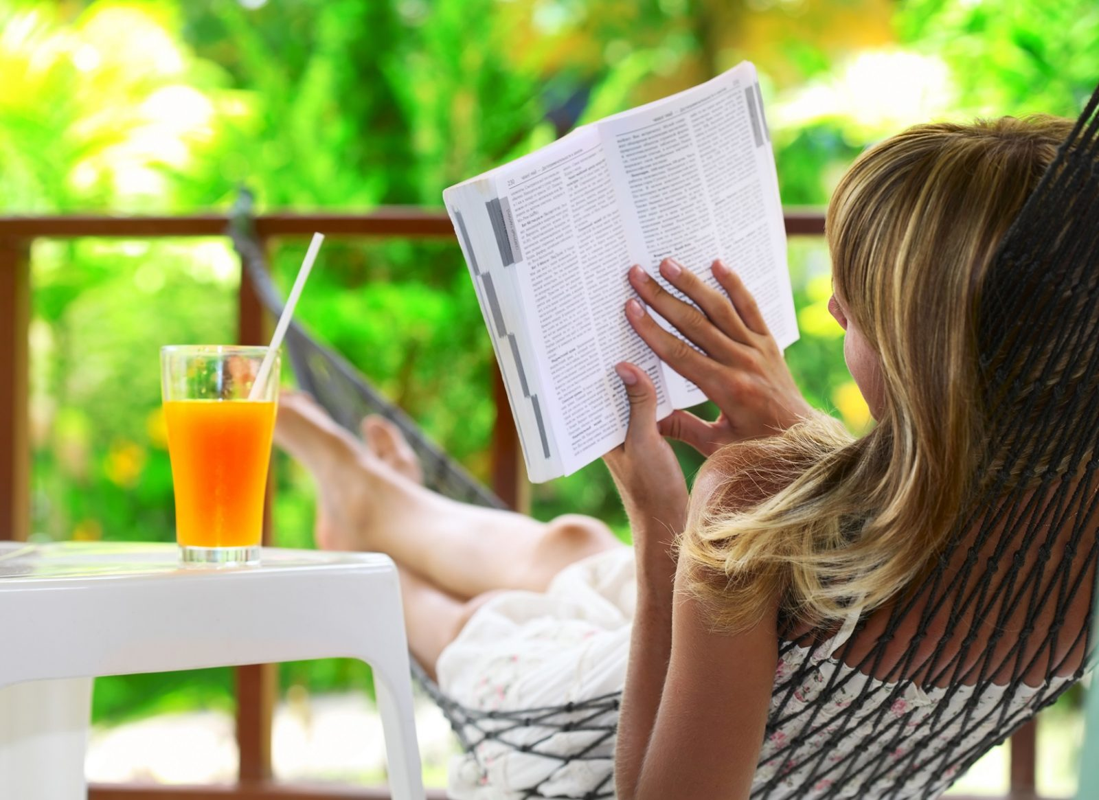 Give mom some alone time to relax with a good book and a drink. (ShutterStock)