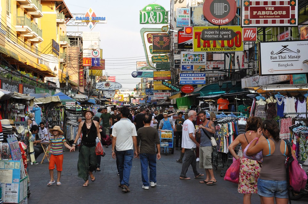 Tourists mill around Bangkok. 1000 Words / Shutterstock