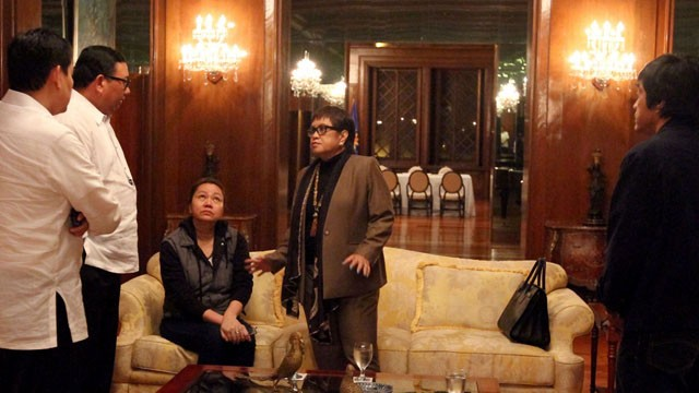 Janet Lim Napoles (sitting) surrenders in Malacanang on August 28, 2013. Photo courtesy of Malacanang Photo Bureau.