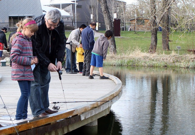 Minister Campbell and a young girl make the ceremonial first cast off.