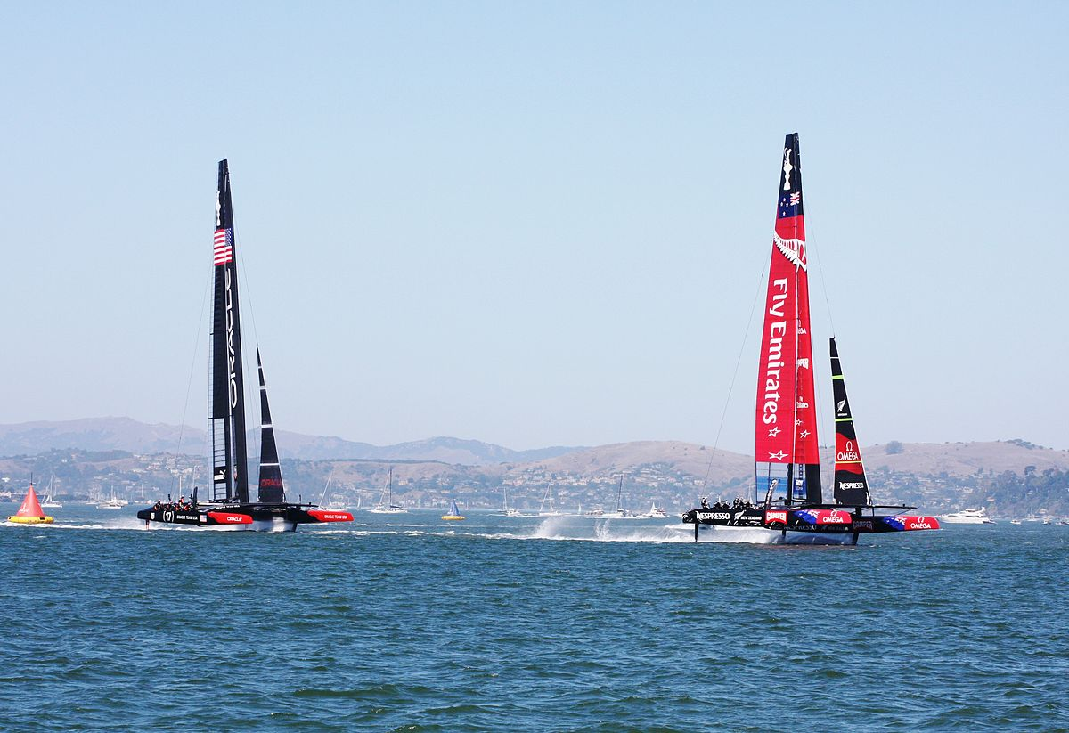 Team New Zealand leading Oracle Racing at the first mark in the first race of the 2013 America's Cup. Photo by Donan.raven / Wikimedia Commons.