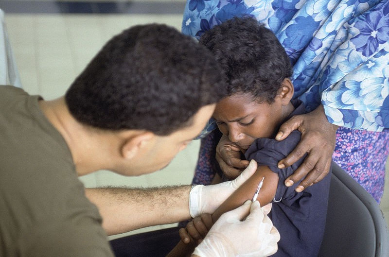 A Somali boy receives  vaccination at the Tunisian hospital in Mogadishu. The hospital treats local diseases, malnutrition, and other injuries. Photo by PV2 Andrew W. McGalliard / Wikimedia Commons.