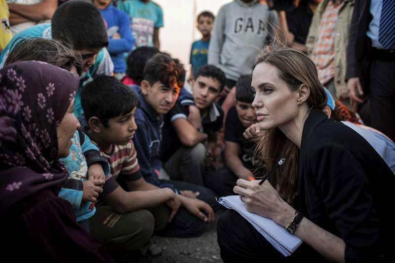 UNHCR Special Envoy Angelina Jolie (right) records the stories of refugees who have just escaped the war in Syria at the Jaber border crossing in Jordan on 18 June 2013. Photo: UNHCR/O. Laban-Mattei