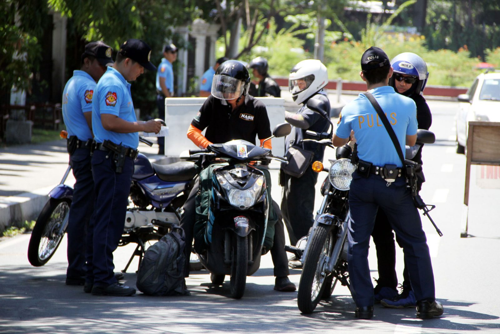 "Philippines National Police (PNP) conducts check point in Intramuros, Manila on Tuesday (June 24), during celebration of the Feast of John the Baptist. It also marks the 443rd Foundation Day of the City of Manila. The putting up of check points aims to address crimes involving ""riding in tandem"". (PNA photo by Jess M. Escaros Jr.)"