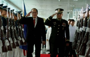 President Benigno S. Aquino III, accompanied by Armed Forces of the Philippines (AFP) Vice Chief of Staff Lt. Gen. Gregorio Pio Catapang Jr., reviews the honor guard prior to his departure from the Ninoy Aquino International Airport (NAIA) Terminal II on Tuesday (June 24, 2014) to attend the Summit Meeting & Working Lunch with Japan Prime Minister Shinzo Abe in Tokyo and the Consolidation for Peace for Mindanao Conference in Hiroshima organized by the Japan International Cooperation Agency (JICA) and the Research and Education for Peace of the Universiti Sains Malaysia. (Photo by Rolando Mailo/Malacañang Photo Bureau/PNA)