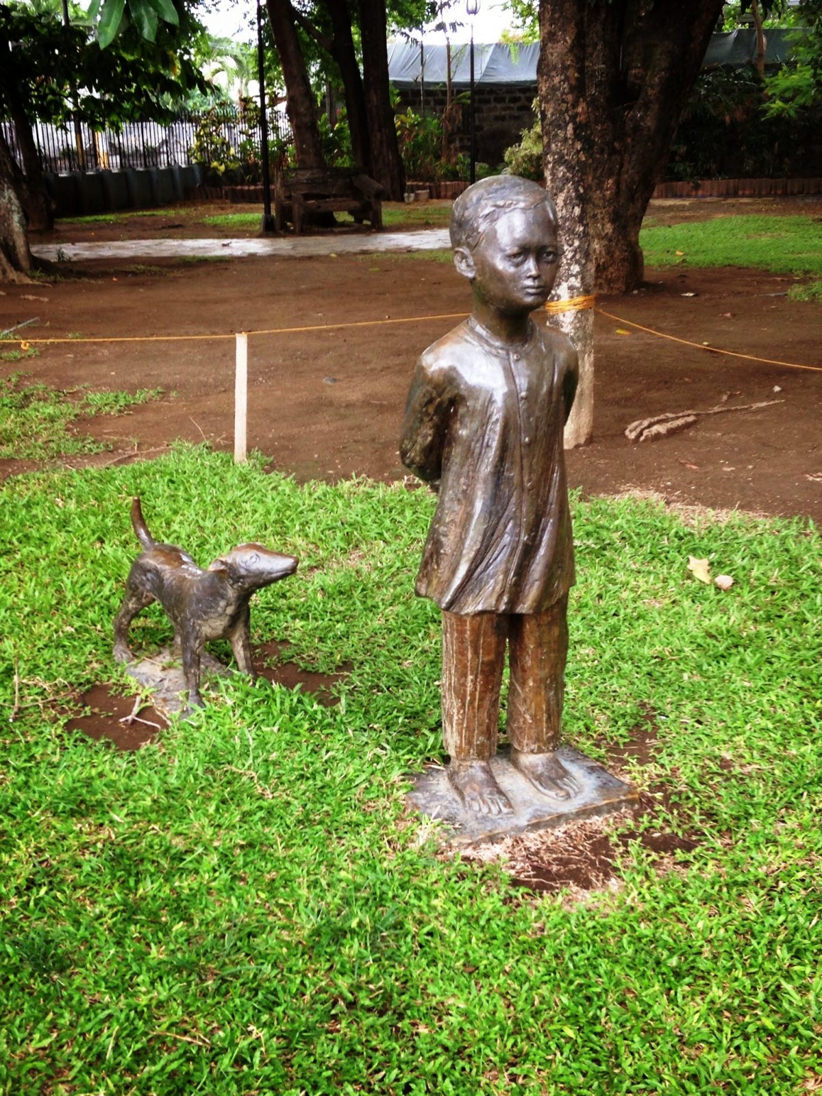 A young Jose Rizal and his dog. Sculpture by Dudley Diaz.