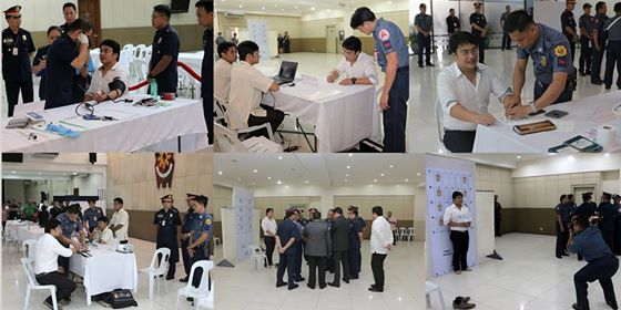 Senator Ramon Revilla Jr. undergoes mandatory booking procedure in Camp Crame, witnessed by family members, lawyers and supporters, after he voluntarily surrendered to the Sandiganbayan on Friday. The Court has manifested that it has taken Sen. Revilla into custody because he voluntarily surrendered and that there is no need to serve the Warrant of Arrest. The booking process involved physical and medical examination, fingerprinting and mugshot. (PNP-PIO)