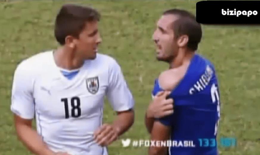 Luis Suarez of Uruguay bit Italy's Giorgio Chiellini during their FIFA World Cup match. Screenshot of Bizipapo HD footage.