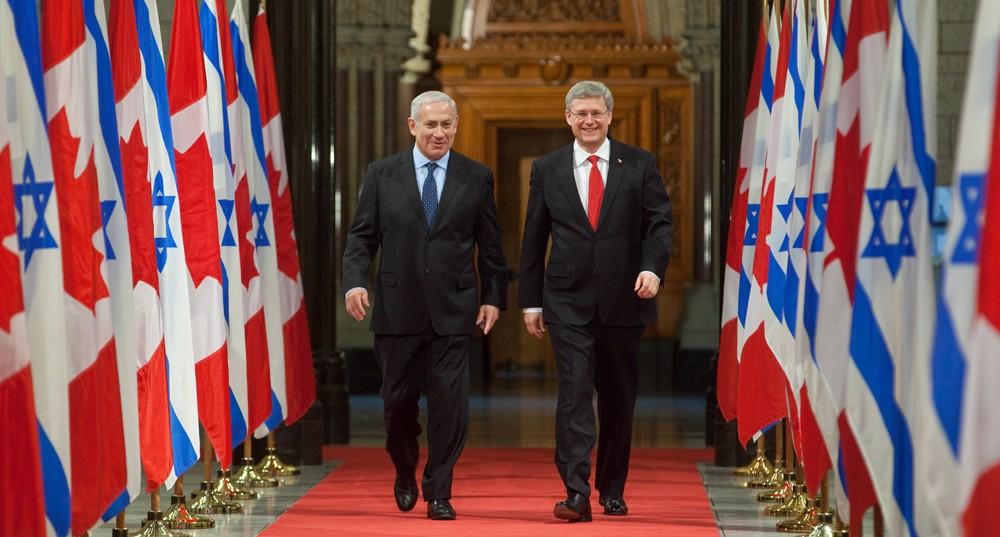 Prime Minister Stephen Harper and Israeli Prime Minister Benjamin Netanyahu walk down the Hall of Honour in Ottawa. Photo from jewishtribune.ca.