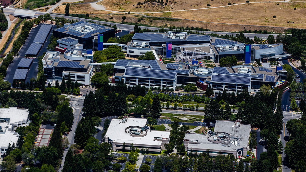 Aerial view of the main Google Campus in Mountain View, CA. Photo by Austin McKinley / Wikimedia Commons.