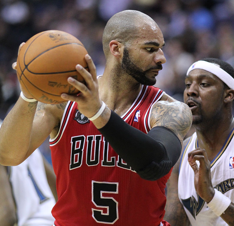 Carlos Boozer and Andray Blatch at a Wizards v/s Bulls game. Photo by Keith Allison / Flickr.