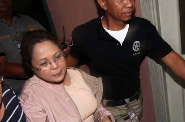Gigi Reyes upon arrest. Photo courtesy of Carlos Santa Maria via Twitter.