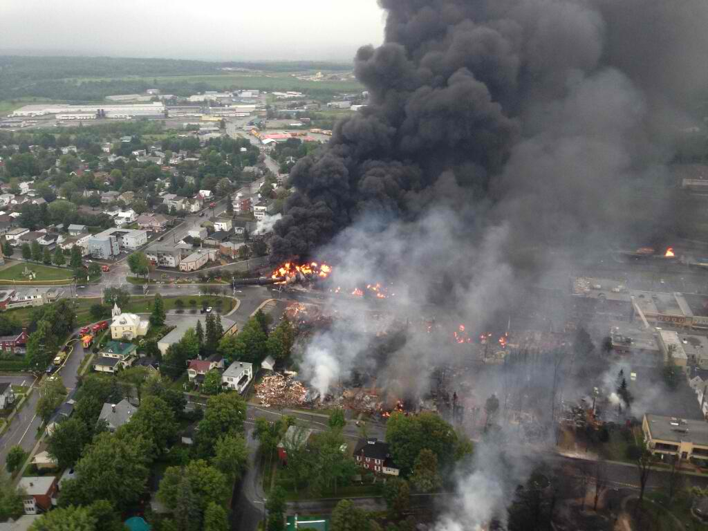Picture taken from a helicopter of Lac-Mégantic, the day of the derailment. Photo by Sûreté du Québec / Twitter.