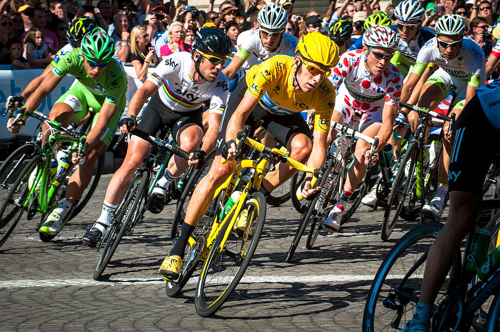 TOUR DE FRANCE 2012 Four jersey wearers on the final stage: (from left) Peter Sagan, green jersey winner; Mark Cavendish, World Champion; Bradley Wiggins, General Classification winner; and Thomas Voeckler, King of the Mountains winner. (Wikipedia photo)
