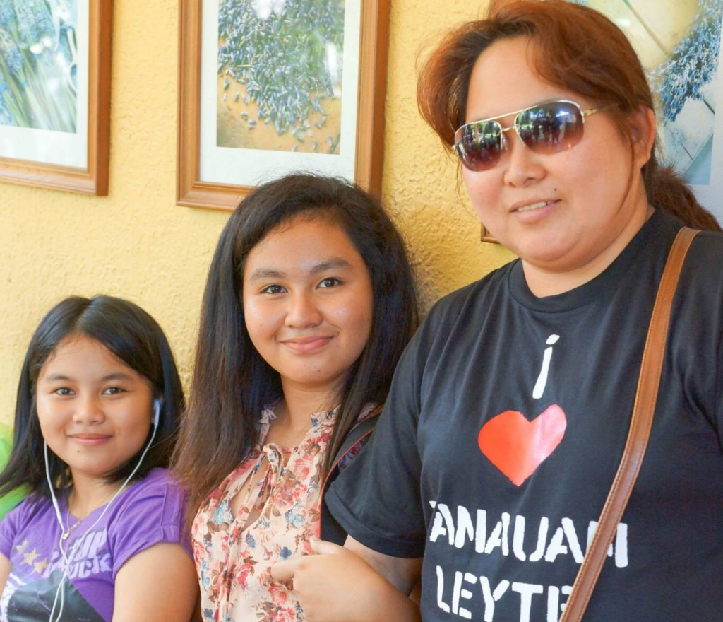 Nenita with daughter Samantha (younger) and orphan niece Maeve.