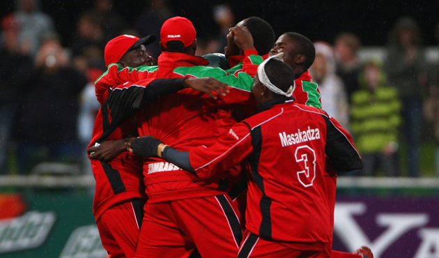 Brendon Taylor of Zimbabwe is mobbed by teammates after scrong the winning runs during the ICC Twenty20 World Championship match between Austalia and Zimbabwe. Photo by Tom Shaw / Getty Images / icc-cricket.com.