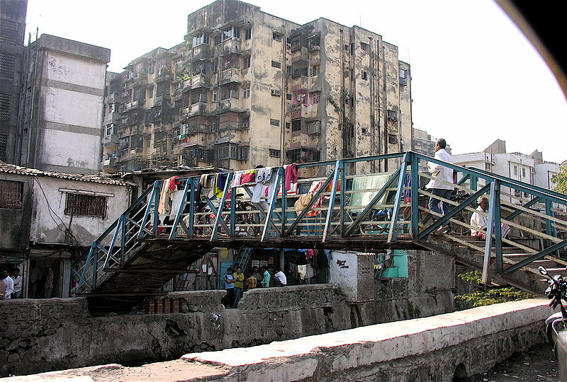 An entrance to the largest slum in Mumbai, and in all of Asia – home to more than one million people. Photo by Jon Hurd / Flickr.