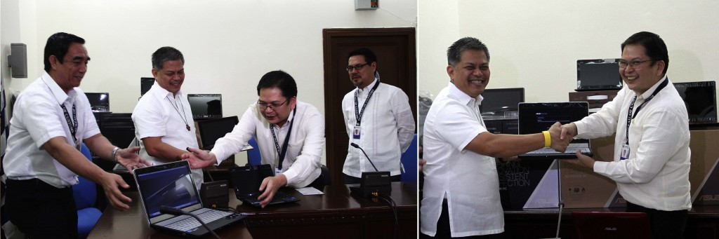 Bureau of Custom (BOC) Commissioner John Philip Sevilla (at right) hands over the one of the 3,915 computer laptops to Department of Education (DepEd) Secretary Bro Armin Luistro during the ceremonial turnover of the seized smuggled laptops on Thursday (August 28, 2014) at the BOC head office in Port Area, Manila. Luistro said 2,000 of these laptops will be issued to the Mobile Teachers and Abot Alam Programs to enhance the computerization program of the DepEd. (PNA photos by Avito C. Dalan)