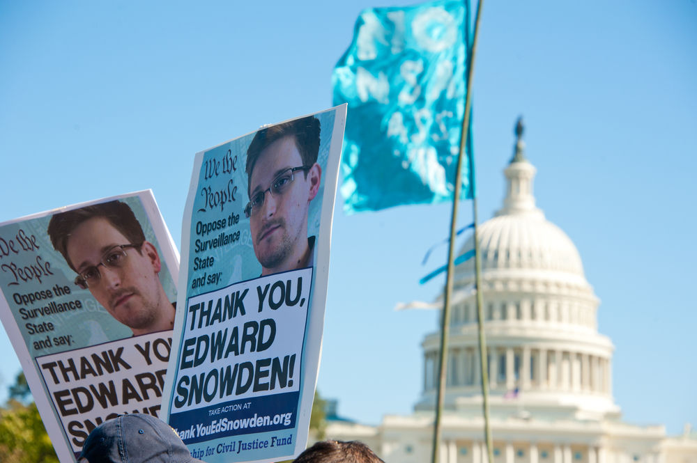 Signs held by protesters during a rally against mass surveillance in Washington, DC on October 26, 2013. (Rena Schild / Shutterstock)